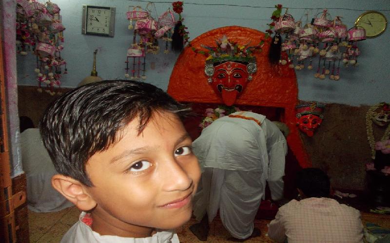 The craze of devotees in offering puja in Jahura Kali Temple in Malda.